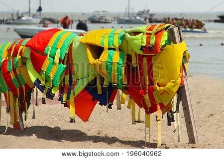 Colorful Life Jackets Save Your Life. Safety In Water. Rescue Service On The Beach. Injuries To Wate
