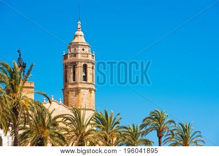 View Of The Tower Of The Church Of Sant Bartomeu And Santa Tecla In Sitges,  Barcelona, Catalunya, S