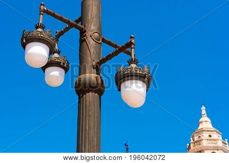 Street lamp against the blue sky in Sitges Barcelona Catalunya Spain. Copy space for text. Isolated on blue background. Close-up poster