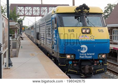 Bay Shore NY USA - 29 June 2017: A double decker train arrives at the Bay Shore train station the week before the Summer of hell is to begin.