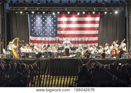East Islip NY USA - 15 July 2017: The new Long Island Concert Orchestra performs for free at night under the stars at Heckshire State Park to honor our hometown heroes.