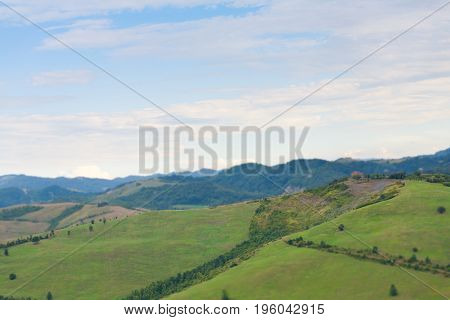 Tilt Shift Of Green Panorama Tuscan Hills On A Sunny Day Landscape In Italy