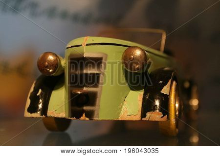 An old wooden toy car, finely crafted in days gone by