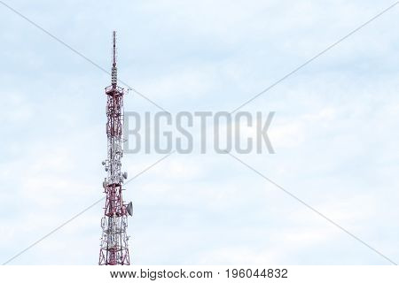 TV radio tower against cloudy sky data transfer technology