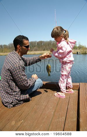 A father and daughter go fishing