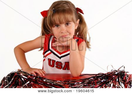 A cute girl in a cheerleading outfit
