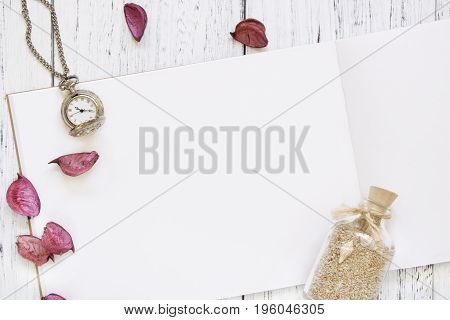 Stock Photography Flat Lay Vintage White Painted Wood Table Purple Flower Petals Pocket Clock Glass