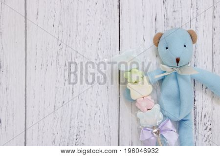 Stock Photography Flat Lay Vintage White Painted Wood Table Blue Bear Doll Holding Cotton Candy