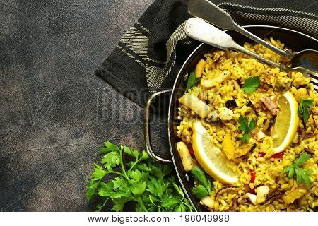 Traditional Spanish (valencian) Dish Paella - Stew With Rice And Seafood.top View With Copy Space.