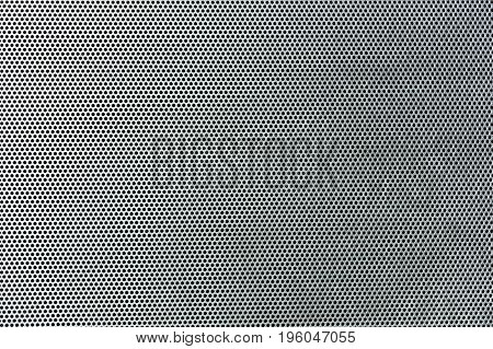 Gray metallic background with perforation of round holes