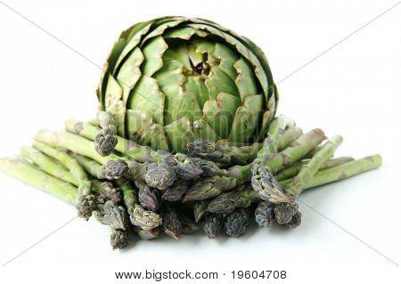A still life of an artichoke and asparagus
