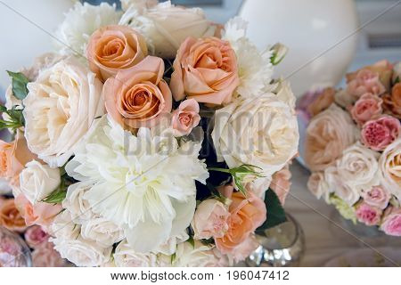 beautiful festive table decoration with peonies and roses