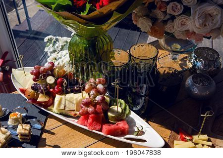 festive table decoration with fruit bowl and flowers