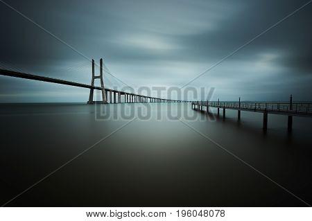 Vasco da Gama bridge in Lisbon, Portugal on a cloudy day