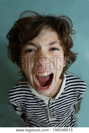 teenager boy with nervous breakdown upset close up photo