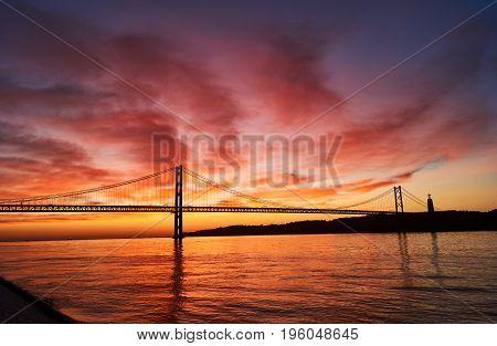 April 25th bridge in Lisbon, Portugal at sunrise