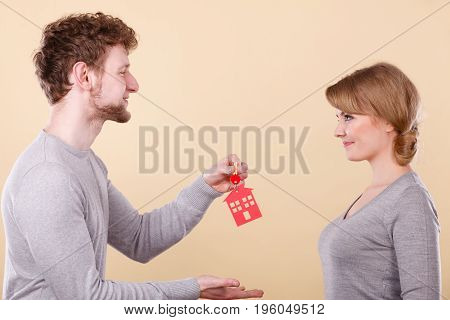 Couple Holding Key With House Symbol