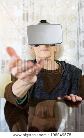 Grandma Using Virtual Reality Goggles