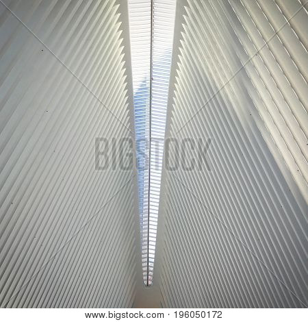 Ceiling of parallel lines and glass meeting at center