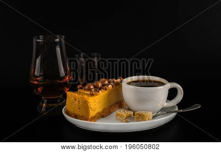 Aromatic Black Coffee In White Cup With Cheesecake On White Saucer, Single Malt, And Coffee Liqueur,