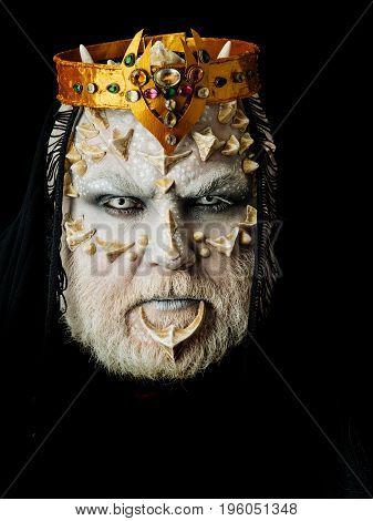 King With Reptilian Skin And Grey Beard