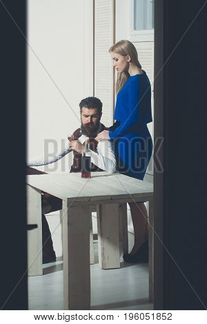 Girl Standing At Man Drinking Wine