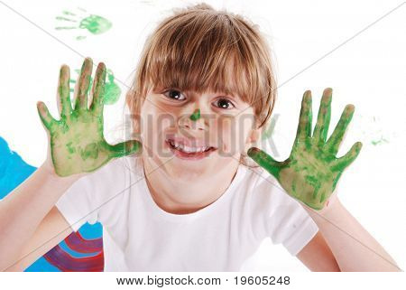 A cute young girl with paint on her hands