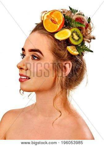 Hair mask from fresh exotic fruits on woman head. Girl with beautiful face hold ingredient for homemade organic skin and hair therapy. Concept of healthy and beauty hair and skin. Natural cosmetic.