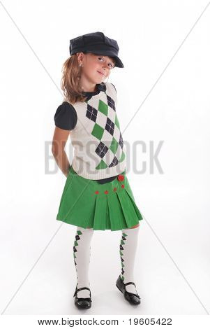 A cute young girl wearing a  back to school outfit