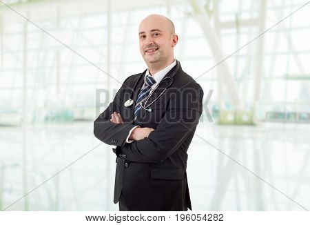 happy male doctor at the hospital