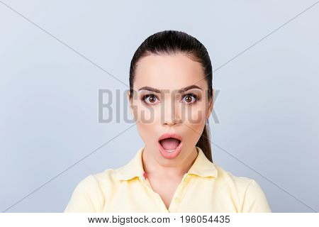 No Way! Close Up Portrait Of Amazed Young Freelancer Brunette Lady, She Stands In Yellow Tshirt On P