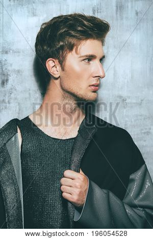 Men's beauty, fashion. Portrait of a handsome male model posing in stylish clothes. Studio shot.