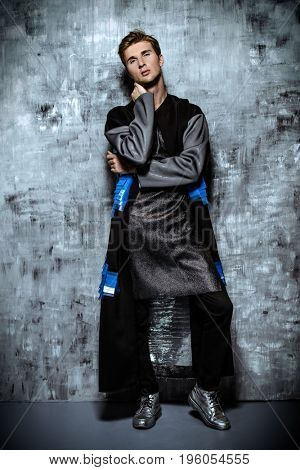 Men's beauty, fashion. Full length portrait of a handsome male model posing in stylish clothes. Studio shot.