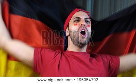 German Guy Waving Germany Flag