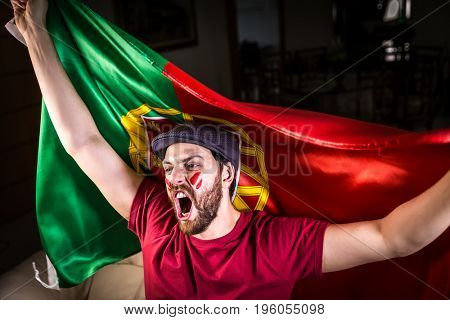 Portuguese fan holding the national flag