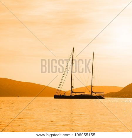 Seascape with silhouette of sail ship