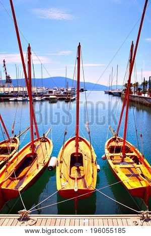 Wooden sail boats on the berth