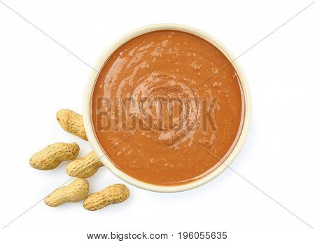 Peanut butter in ceramic bowl on white background