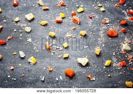 Delicious broken candies on grey background