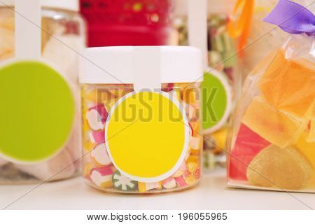 Different sweets on table at candy shop