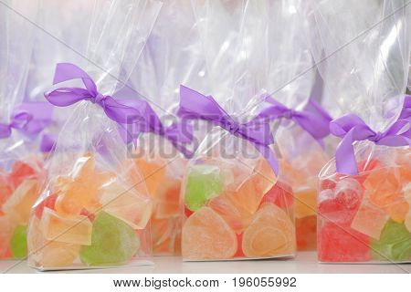 Tasty jelly candies in bags at shop