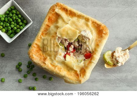 Composition with turkey pot pie on light gray background