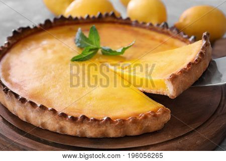 Taking piece of delicious lemon pie, closeup