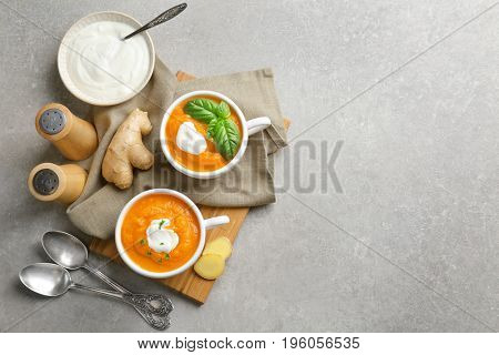 Composition with delicious carrot soup on table