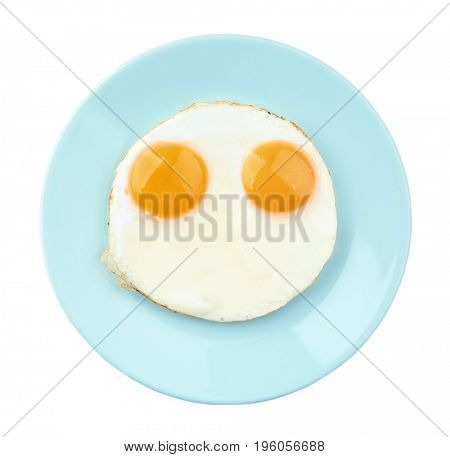Plate with fried sunny side up eggs on white background