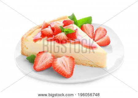 Plate with piece of homemade strawberry cake on white background