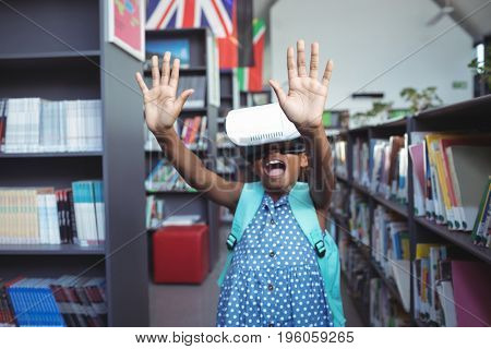 Girl gesturing and screaming while wearing virtual reality simulator in library