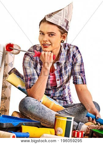 Repair home woman holding paint roller for wallpaper. Aggressive screaming girl in newspaper cap renovation apartment on isolated. Girl is glad to choose right materials. Repair of the hostel.