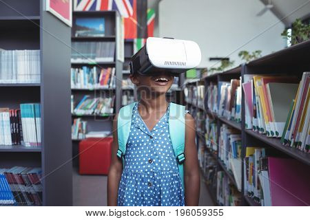 Girl smiling while wearing virtual reality simulator in library
