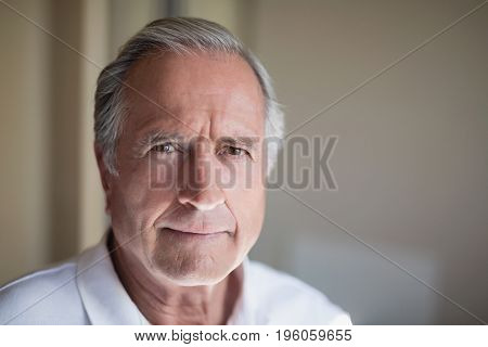 Close-up portrait of senior male patient at hospital ward